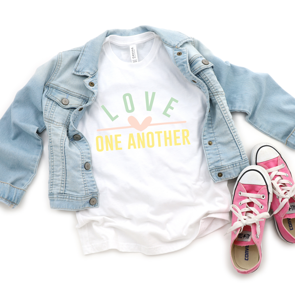 Tshirt with Love One Antoher in pastel colors and a heart