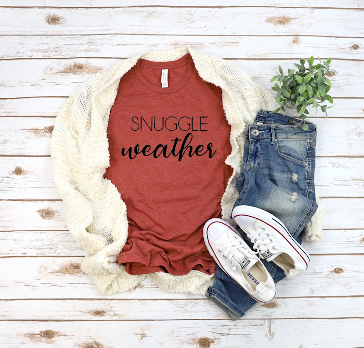 Rust colored shirt with snuggle weather quote