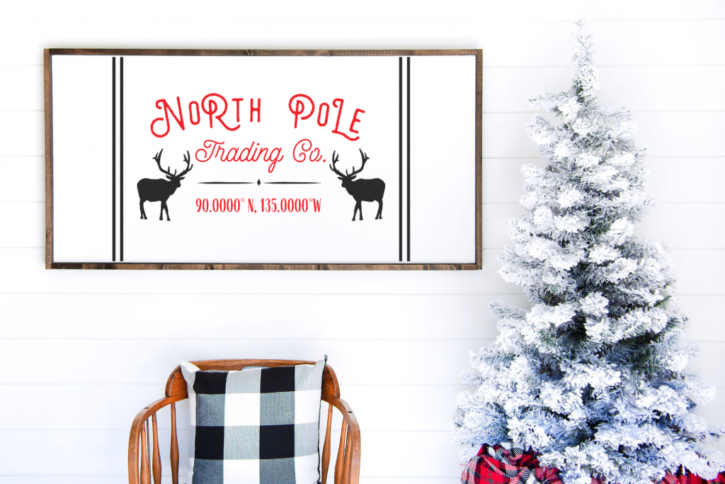 Framed wood North Pole Trading Co. Sign